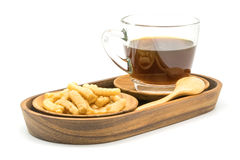 Prawn cracker and a cup of black coffee in a wooden tray Stock Images