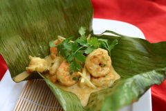 Prawn curry. With coconut milk in banana leaf Stock Image