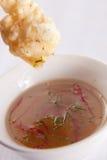 Prawn drop dip. Deep-fried prawn dipped into sweet chilli sauce Stock Photos