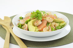 Prawn, grapefruit and avocado salad. Grilled prawns, fresh grapefruit and avocado on a bed of romaine and watercress in white bowl Stock Photos