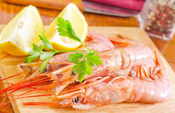 Prawn. And lemons on board Stock Photography
