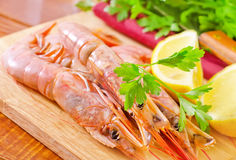 Prawn. And lemons on board Stock Images