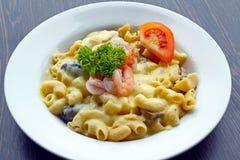 Prawn macaroni pasta. Delicious prawn macaroni pasta with cheese and mushrooms on a white plate Royalty Free Stock Photo