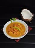 Prawn malai curry on black background Stock Photos