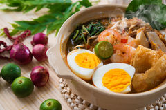 Prawn mee. Prawn noodles. Famous Malaysian food spicy har mee fresh cooked in clay pot with hot steam royalty free stock photos