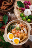 Prawn noodles, prawn mee. Famous Malaysian food har mee spicy fresh cooked in clay pot with hot steam royalty free stock photos