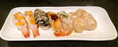 Prawn, Oyster and Scallop Sushi. Lightly Roasted Prawn, Oyster and Scallop Sushi Royalty Free Stock Images
