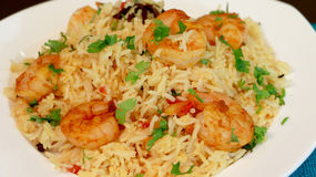 Prawn pulao is a lightly spiced rice and prawn preparation from Stock Images