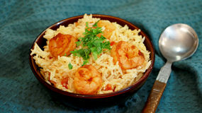 Prawn pulao is a lightly spiced rice and prawn preparation from Stock Image