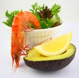 Prawn Salad. Boiled Tiger Prawn Salad accompanied with Lemon and Avocado Royalty Free Stock Images