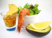 Prawn Salad Cocktail. Boiled Tiger Prawn Salad accompanied with Lemon,Avocado, Nachos and Salsa Stock Photos