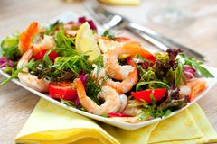 Prawn salad. Simple and healthy salad of shrimp, mixed greens and tomatoes royalty free stock image