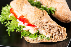 Prawn sandwich on black plate Royalty Free Stock Photography