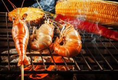 Prawn ,shrimp grilled on barbe-que fire stove with pineapple ,red chilly and corn stock images