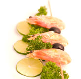 Prawn Skewer with lime and olives Royalty Free Stock Images