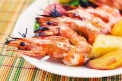 Prawn skewer with a side of baked potatoes Stock Images