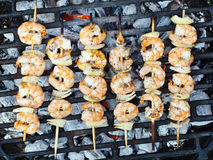 Prawn skewers. On barbeque with onions Royalty Free Stock Photography