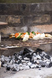 Prawn skewers on a barbecue Stock Images