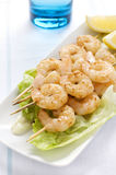 Prawn Skewers with Lemon wedges Royalty Free Stock Photography