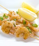 Prawn Skewers with Lemon Wedges Stock Photography