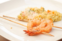 Prawn skewers and risotto Stock Photos