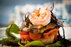 Prawn starter. Delicious prawn starter with salad, aubergine and tomato Royalty Free Stock Image