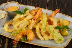 Prawn tempura with vegetables. And sauce royalty free stock images