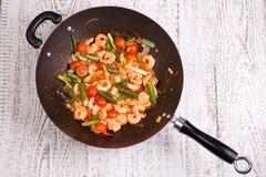 Prawn in wok. On white table Stock Image