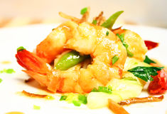 Prawns. A plate of prawns in ginger sauce royalty free stock photos