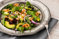 Prawns and avocado salad on the vintage metal plate with fork Royalty Free Stock Photos