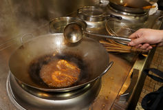 Prawns being fried in wok Royalty Free Stock Photos