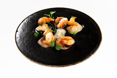 Prawns with black squid ink sauce Stock Photos