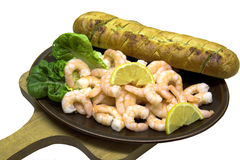 Prawns & Bread. King prawns (shrimps) with lemon and lettuce and a crusty garlic bread Royalty Free Stock Photography