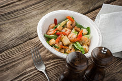 Prawns Caesar salad with fork on the wooden table horizontal Stock Photos
