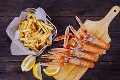Prawns, chips and lemon Royalty Free Stock Photo