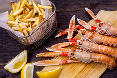 Prawns, chips and lemon Royalty Free Stock Photos