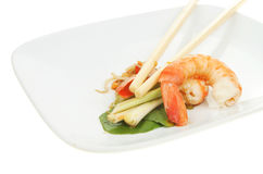 Prawns with chopsticks on a plate Stock Image