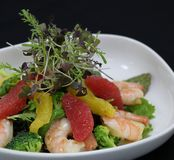 Prawns and citrus fruits salad in a serving bowl royalty free stock photos