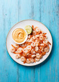 Prawns with cocktail sauce on plate Royalty Free Stock Image