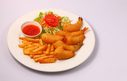 Prawns in crispy batter and salad. Deep fried prawns with salad and chilli with a white background Stock Photography