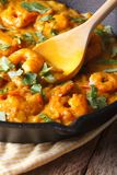 Prawns in curry sauce in a frying pan macro. vertical, rustic Stock Photos