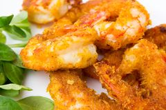 Fried prawns on a white background. Prawns fried in breading close-up Stock Image