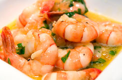 Prawns fried with olive oil and butter. In porcelain dish Royalty Free Stock Photography