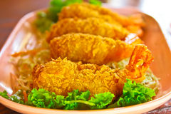 Prawns fritter cover with crisp bread and salad Royalty Free Stock Photography