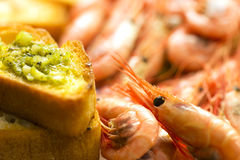 Prawns with garlic bread Stock Photos