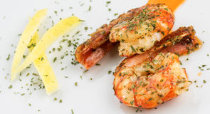 Prawns with garlic and lemon Stock Photography