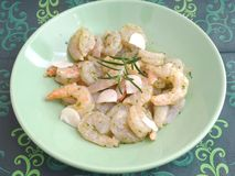 Prawns with garlic oil. Some fresh prawns with garlic and oil Stock Images