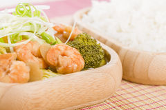 Prawns with Ginger and Spring Onion. Chinese dish of prawns, broccoli and water chestnuts with ginger and spring onion sauce served with steamed rice Royalty Free Stock Photo