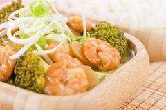 Prawns with Ginger and Spring Onion. Chinese dish of prawns, broccoli and water chestnuts with ginger and spring onion sauce served with steamed rice Stock Images