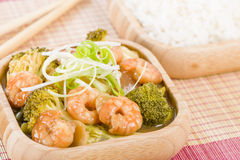 Prawns with Ginger and Spring Onion. Chinese dish of prawns, broccoli and water chestnuts with ginger and spring onion sauce served with steamed rice Stock Photography